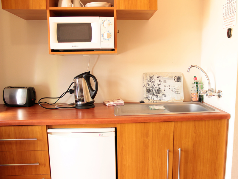 Microwave, fridge, kettle, toaster, crockery and cutlery